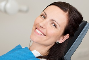 Smiling woman in dental char