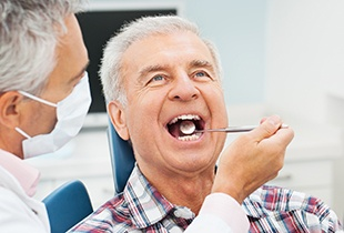 Older man receiving dental exam