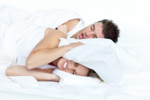 man asleep snoring wife upset