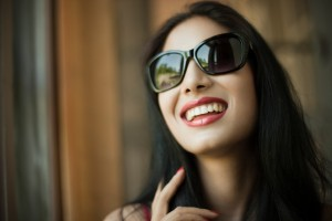 Smiling woman with beautiful teeth thanks to the Arcadia cosmetic dentist